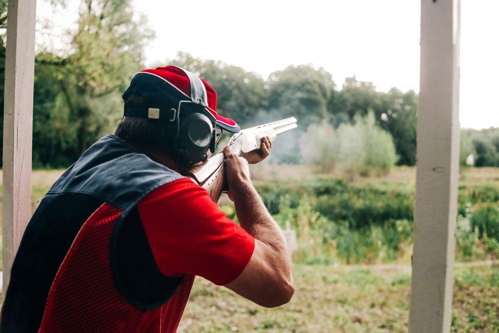 Hunter shoots with a shotgun