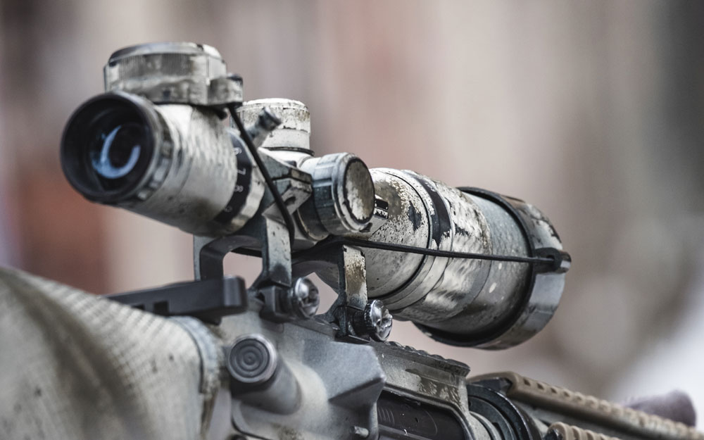 Rifle scope on the street with blurry background